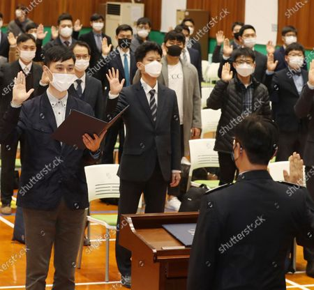 A group of conscientious objectors takes an oath during a ceremony at a correctional facility in the central city of Daejeon, South Korea, 26 October 2020, to enter a training camp for their 36-month alternative military service. After three weeks of education and training, they will be given various assignments at detention facilities in Daejeon or the southwestern city of Mokpo, such as serving and cooking meals and supporting facility management, according to the Military Manpower Administration.