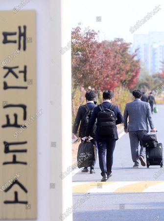 A group of conscientious objectors walks into a correctional facility in the central city of Daejeon, South Korea, 26 October 2020, to enter a training camp for their 36-month alternative military service. After three weeks of education and training, they will be given various assignments at detention facilities in Daejeon or the southwestern city of Mokpo, such as serving and cooking meals and supporting facility management, according to the Military Manpower Administration.