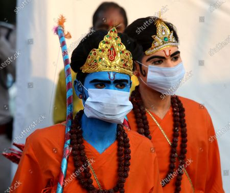 Men dressed as Lord Rama (L) and his brother Laxmana wear a protective face mask during Dussehra festival celebrations in Bhopal, India, 26 October 2020. Limited people were allowed inside the Dussehra festival area due to Indian government guidelines over the Covid-19 pandemic. Dussehra is an annual Hindu festival, which follows the nine-day festival of Navratri and marks the victory of the mythological Hindu God Lord Rama over the evil demon king Ravana.
