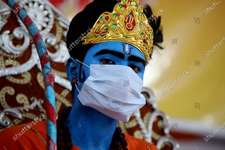 A man dressed as Lord Rama wears a protective face mask during Dussehra festival celebrations in Bhopal, India, 26 October 2020. Limited people were allowed inside the Dussehra festival area due to Indian government guidelines over the Covid-19 pandemic. Dussehra is an annual Hindu festival, which follows the nine-day festival of Navratri and marks the victory of the mythological Hindu God Lord Rama over the evil demon king Ravana.