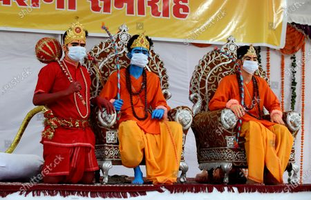 Men dressed as Lord Rama (C), his brother Laxmana (R) and Lord Hanumaan wear a protective face mask during Dussehra festival celebrations in Bhopal, India, 26 October 2020. Limited people were allowed inside the Dussehra festival area due to Indian government guidelines over the Covid-19 pandemic. Dussehra is an annual Hindu festival, which follows the nine-day festival of Navratri and marks the victory of the mythological Hindu God Lord Rama over the evil demon king Ravana.