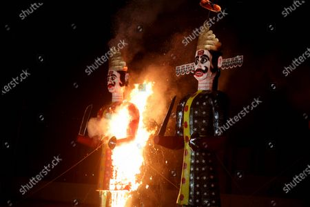 Effigies of demon king Ravana (R) and Meghnath burn during Dussehra festival celebrations in Bhopal, India, 26 October 2020. Limited people were allowed inside the Dussehra festival area due to Indian government guidelines over the Covid-19 pandemic. Dussehra is an annual Hindu festival, which follows the nine-day festival of Navratri and marks the victory of the mythological Hindu God Lord Rama over the evil demon king Ravana.