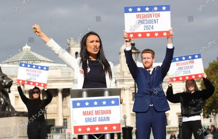 Stock Photo of Ahead of the most controversial US Presidential Election ever, bookmaker Ladbrokes launches its 'Making Meghan Great Again' campaign to celebrate the Duchess of Sussex's chances of winning the 2024 US Election. Meghan is priced at 50/1 with the bookmakers to win the 2024 US Election. The celebrity couple were played by look-a-likes of Meghan and Prince Harry outside locations including Planet Hollywood, Parliament Square and Buckingham Palace.