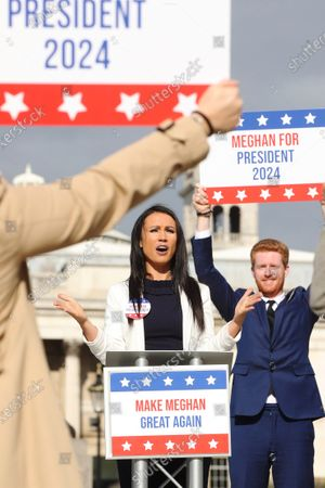 Stock Image of Ahead of the most controversial US Presidential Election ever, bookmaker Ladbrokes launches its 'Making Meghan Great Again' campaign to celebrate the Duchess of Sussex's chances of winning the 2024 US Election. Meghan is priced at 50/1 with the bookmakers to win the 2024 US Election. The celebrity couple were played by look-a-likes of Meghan and Prince Harry outside locations including Planet Hollywood, Parliament Square and Buckingham Palace.