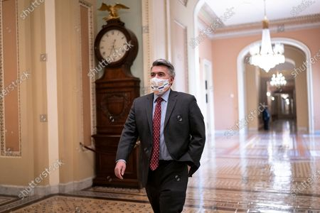 Sen. Cory Gardner, R-Colo., walks to the chamber for a procedural vote prior to final roll call on confirmation of Amy Coney Barrett to the Supreme Court, at the Capitol in Washington