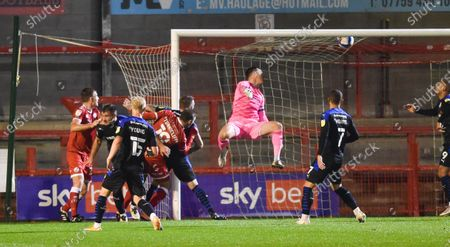 Jordan Tunnicliffe of Crawley heads in their third goal past the Tranmere goalkeeper Scott Davies  during the League Two match between Crawley Town and Tranmere Rovers at the People's Pension Stadium  , Crawley ,  UK - 27th October 2020