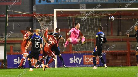 Stock Picture of Jordan Tunnicliffe of Crawley heads in their third goal past the Tranmere goalkeeper Scott Davies  during the League Two match between Crawley Town and Tranmere Rovers at the People's Pension Stadium  , Crawley ,  UK - 27th October 2020