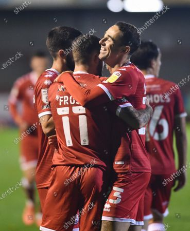 Fourth goalscorer Tyler Frost of Crawley is hugged by Sam Ashford  during the League Two match between Crawley Town and Tranmere Rovers at the People's Pension Stadium  , Crawley ,  UK - 27th October 2020