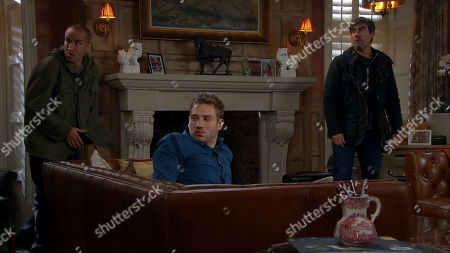 Stock Photo of Emmerdale - Ep 8879 Wednesday 4th November 2020 As Jamie Tate, as played by Alexander Lincoln, wallows in his brandy he is soon confronted by Sam a Dingle, as played by James Hooton, and Cain Dingle, as played by Jeff Hordley, for a 'chat' all unaware that a hidden Mackenzie is watching. As Cain reveals their plan to a drunk Jamie, a listening Mackenzie's interest is piqued and soon he steps out of the shadows. Has Jamie found a new alliance?