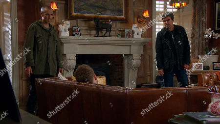 Stock Image of Emmerdale - Ep 8879 Wednesday 4th November 2020 As Jamie Tate, as played by Alexander Lincoln, wallows in his brandy he is soon confronted by Sam a Dingle, as played by James Hooton, and Cain Dingle, as played by Jeff Hordley, for a 'chat' all unaware that a hidden Mackenzie is watching. As Cain reveals their plan to a drunk Jamie, a listening Mackenzie's interest is piqued and soon he steps out of the shadows. Has Jamie found a new alliance?