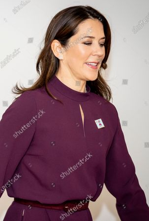 Denmark's Crown Princess Mary wears a pin depicting this year's Christmas stamp during its presentation at Julemaerkehjemmet Liljeborg in Roskilde, Denmark, 26 October 2020. Since 1904, the Christmas Stamp Foundation has annually published a special Christmas Stamp which aims at raising money for children at one of Denmark's five Christmas Stamp Homes. At those home some 1,000 children every year can stay and receive help in combating loneliness, bullying, social isolation and obesity.
