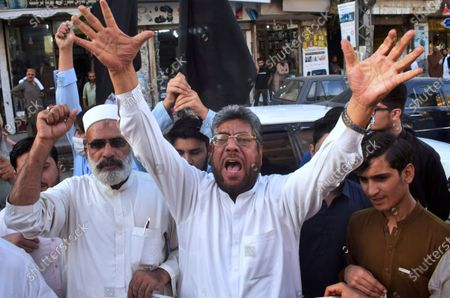 Pakistan traders chant anti-French slogans against the publishing of caricatures of the Prophet Muhammad they deem blasphemous, in Peshawar, Pakistan, . Pakistan's Prime Minister Imran Khan said the French leader chose to encourage anti-Muslim sentiment and deliberately provoke Muslims by encouraging the display of blasphemous cartoons targeting Islam