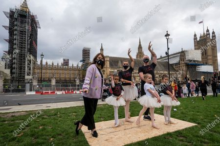 """Choreographer Arlene Phillips (L) joins ballet dancers performing during """"Survival in the Square"""", on day one of a week long series of creative taking place each day in Parliament Square. The events is organised by #WeMakeEvents, an international movement to highlight that the live events sector urgently needs support from local governments to survive the Covid-19 crisis."""