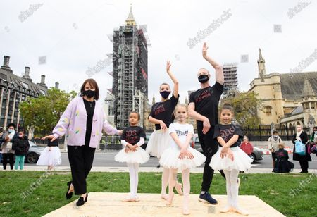 Ballet dancers, accompanied by a 130 strong orchestra perform in parliament Square as part of #wemakeevents stages 'Survival in the Square' initiative.Taking place across 6 days 'Survival in the Square' is a series of individual performances being held to raise awareness of the current plight facing the entertainment industry as a result of the Covid 19 crisis. Arlene Phillips with a group of Dancers