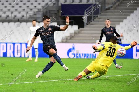 Ferran Torres of Manchester City beats Steve Mandanda of Marseille to put his side 1-0 ahead