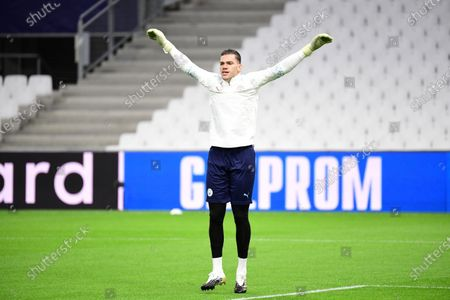 Ederson Moraes of Manchester City warms up before the game