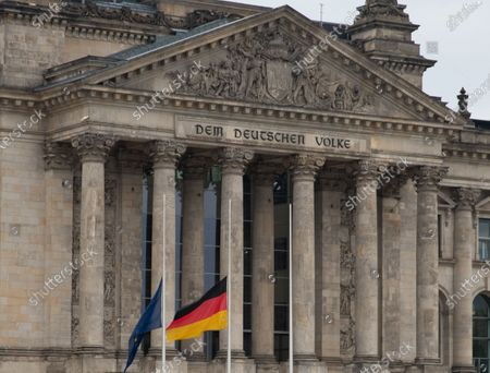 Flags are at half mast in front of the German parliament Bundestag building in Berlin, Germany, 26 October 2020. German Parliament Vice President Thomas Oppermann has died after suddenly collapsing while waiting for a live TV interview in the evening on 25 October.