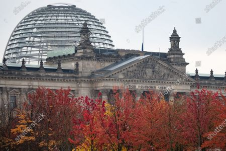 Trees with autumn foliage are seen in front of the German parliament Bundestag building in Berlin, Germany, 26 October 2020. German Parliament Vice President Thomas Oppermann has died after suddenly collapsing while waiting for a live TV interview in the evening on 25 October.