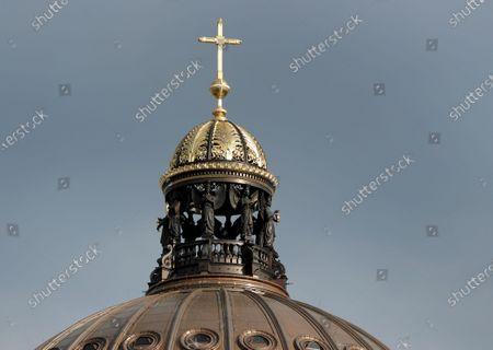 Exterior view of the catholic cross on top of the dome of the Humboldt Forum in the New Berlin City Palace in Berlin, Germany, . In the summer of 2002 the German Bundestag passed a resolution to reconstruct the Berlin City Palace as the Humboldt Forum which will be opened partly late 2020