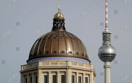 Exterior view of the dome of the Humboldt Forum in the New Berlin City Palace next to the TV tower in Berlin, Germany, . In the summer of 2002 the German Bundestag passed a resolution to reconstruct the Berlin City Palace as the Humboldt Forum which will be opened partly late 2020