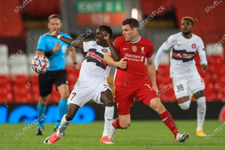 James Milner (7) of Liverpool fowls Pione Sisto (7) of FC Midtjylland