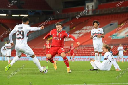 Paulinho (29) of FC Midtjylland tackles Xherdan Shaqiri (23) of Liverpool  by the box