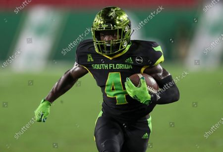 South Florida Bulls wide receiver Omarion Dollison (4) runs with the ball during an NCAA football game on in Tampa, Fla