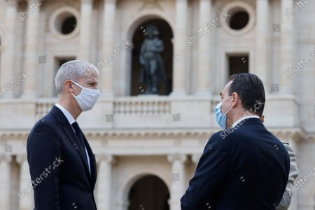 Romanian Prime Minister Ludovic Orban (R) speaks with French Junior Minister of Foreign Trade Franck Riester (L) during a  welcoming ceremony in the courtyard of the Invalides in Paris, France, 26 October 2020, at the start of a two-day official visit.