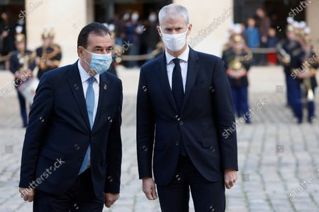 Romanian Prime Minister Ludovic Orban (L) speaks with French Junior Minister of Foreign Trade Franck Riester (R) during a  welcoming ceremony in the courtyard of the Invalides in Paris, France, 26 October 2020, at the start of a two-day official visit.