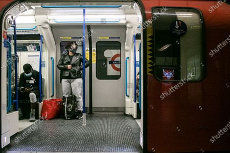 Passenger numbers remain down on the London Underground and trains are  not busy particularly at rush hour.  as the government imposes tighter Coronavirus covid 19.  Members of the public are required to wear face coverings which has become mandatory on public tranport where social distancing is not possible