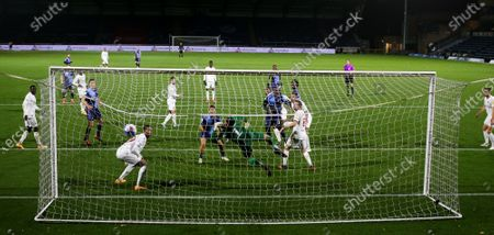 Anthony Stewart of Wycombe Wanderers heads the equalising goal past Ben Foster of Watford