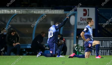 Adebayo Akinfenwa of Wycombe Wanderers  takes a knee before the game - Gareth Ainsworth - Manager of Wycombe Wanderers (L)