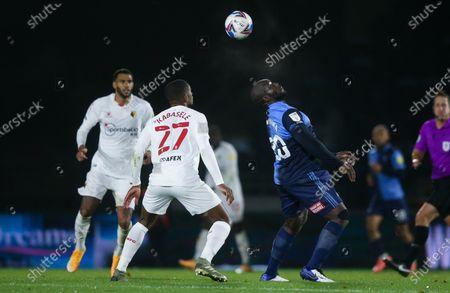 Adebayo Akinfenwa of Wycombe Wanderers & Christian Kabasele of Watford
