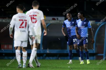 Stock Picture of all smiles for Anthony Stewart of Wycombe Wanderers (5 goal scorer) and Dennis Adeniran of Wycombe Wanderers after the game after they get a point against Watford