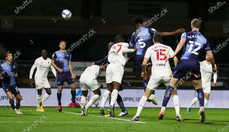 Anthony Stewart of Wycombe Wanderers heads the equalising goal