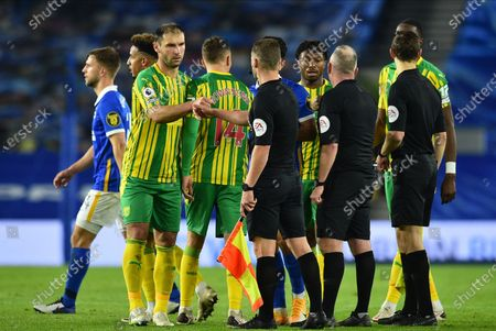 Branislav Ivanovic of West Bromwich bumps on fist the match officials after the English Premier League match between Brighton & Hove Albion and West Bromwich Albion in Brighton, Britain, 26 October 2020.