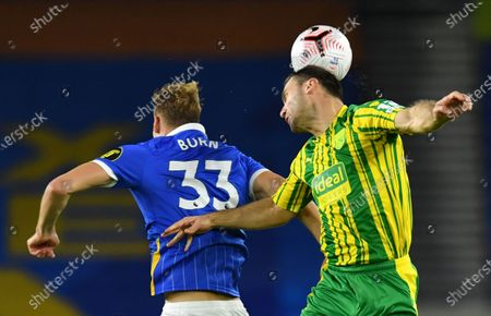 Dan Burn (L) of Brighton in action against Branislav Ivanovic (R) of West Bromwich during the English Premier League match between Brighton & Hove Albion and West Bromwich Albion in Brighton, Britain, 26 October 2020.