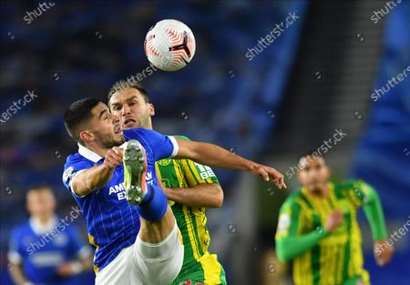 Neal Maupay (L) of Brighton in action against Branislav Ivanovic (2L) of West Bromwich during the English Premier League match between Brighton & Hove Albion and West Bromwich Albion in Brighton, Britain, 26 October 2020.