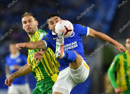 Neal Maupay (R) of Brighton in action against Branislav Ivanovic (L) of West Bromwich during the English Premier League match between Brighton & Hove Albion and West Bromwich Albion in Brighton, Britain, 26 October 2020.