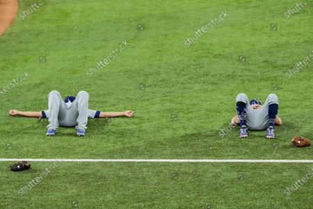 Arlington, Texas, Sunday, October 25, 2020 Corey Seager, left, and Chris Taylor meditate on the field before taking on the Rays in game five of the World Series at Globe Life Field. (Robert Gauthier/ Los Angeles Times)
