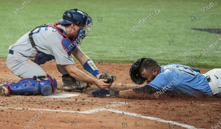 Arlington, Texas, Sunday, October 25, 2020 Tampa Bay Rays right fielder Manuel Margot (13) is tagged out by Los Angeles Dodgers catcher Austin Barnes (15) on an attempted steal of home in the 4th inning in game five of the World Series at Globe Life Field. (Robert Gauthier/ Los Angeles Times)