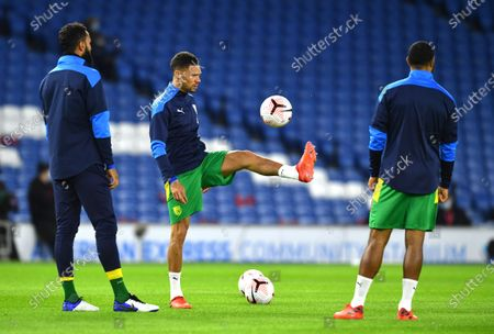 West Bromwich Albion's Kieran Gibbs, centre, warms up prior to the English Premier League soccer match between Brighton and West Bromwich Albion at the American Express Community Stadium in Brighton, England