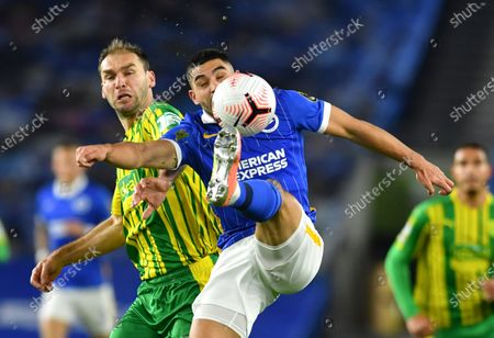 Brighton's Neal Maupay, right, and West Bromwich Albion's Branislav Ivanovic challenge for the ball during the English Premier League soccer match between Brighton and West Bromwich Albion at the American Express Community Stadium in Brighton, England