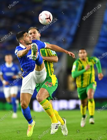 Brighton's Neal Maupay, left, and West Bromwich Albion's Branislav Ivanovic challenge for the ball during the English Premier League soccer match between Brighton and West Bromwich Albion at the American Express Community Stadium in Brighton, England