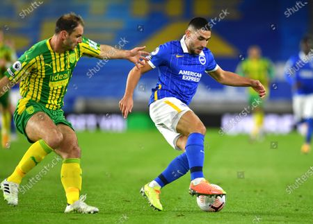 West Bromwich Albion's Branislav Ivanovic, left, and Brighton's Neal Maupay challenge for the ball during the English Premier League soccer match between Brighton and West Bromwich Albion at the American Express Community Stadium in Brighton, England