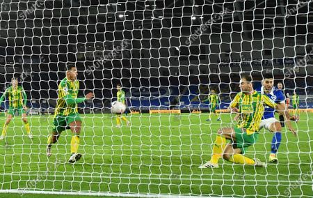 West Bromwich Albion's Branislav Ivanovic, second right, hits the ball into West Bromwich Albion's Jake Livermore, left, and then into the net for an own-goal 1-0 to Brighton during during the English Premier League soccer match between Brighton and West Bromwich Albion at the American Express Community Stadium in Brighton, England
