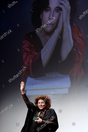 Charo Lopez poses for photographers after receiving an award as a tribute to her acting career at the Valladolid International Film Festival, in Valladolid, Spain, 26 October 2020. The 65th SEMINCI runs from 24 to 31 October.