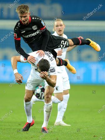 Stock Photo of Leverkusen's Daley Sinkgraven (R) in action against Augsburg's Daniel Caligiuri (L) during the German Bundesliga soccer match between Bayer 04 Leverkusen and FC Augsburg in Leverkusen, Germany, 26 October 2020.