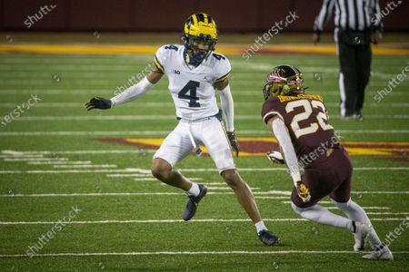 Michigan defensive back Vincent Gray (4) defends Minnesota wide receiver Mike Brown-Stephens (22) in the fourth quarter of an NCAA college football game, in Minneapolis. Michigan won 49-24