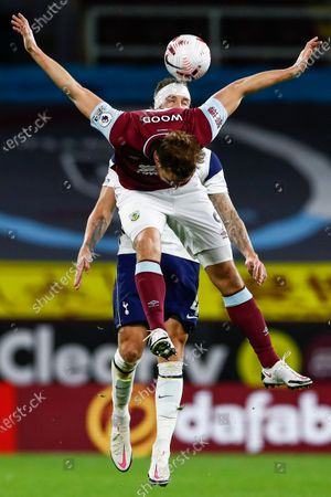 Chris Wood of Burnley (front) in action against Toby Alderweireld of Tottenham (back) during the English Premier League match between Burnley and Tottenham Hotspur in Burnley, Britain, 26 October 2020.